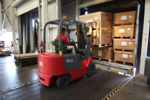 Forklift moving pallets